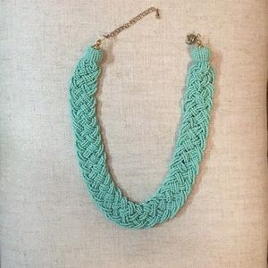 Beaded statement necklace in a turquoise color